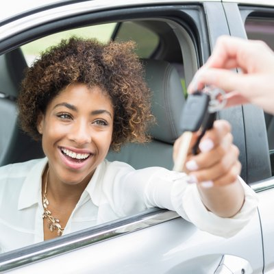 Young woman receiving car keys